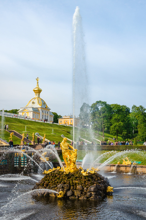 petergof: Petergof, St Petersburg, Russia - September 1, 2012: Samson  tears open the jaws of a lion is the central fountain of The Grand Cascade in The State Museum Preserve Peterhof. There is The Armorial Pavilion of The Grand Palace on the background. Unidenti