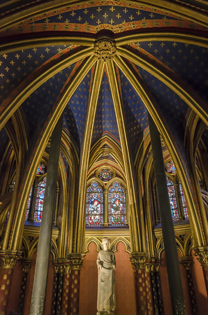 ix: Paris, France - April 18, 2013: Statue of Louis IX in interior of Sainte-Chapelle in Paris. The Chapel was built in 1248 by King Louis IX of France to house Passion relics, including Christs Crown of Thorns - one of the most important relics in medieval