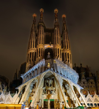 architector: Cathedral of La Sagrada Familia at night. It is designed by architector Antonio Gaudi andl is being build since 1882.