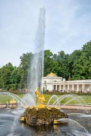 petergof: Petergof, St Petersburg, Russia - September 1, 2012: Samson  tears open the jaws of a lion is the central fountain of The Grand Cascade in The State Museum Preserve Peterhof. Unidentified tourists present on picture. Editorial