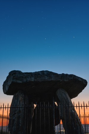megalith: Aylesford, United Kingdom - September 6, 2015: Kits Coty House megalith monument at sunset with copy space in sky of stars as seen on 6th of September, 2015. Editorial
