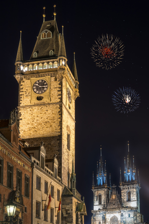 czech culture: View of old town hall tower and church of Mother of God before Tyn Tyn church in Prague at night. Copy space in black sky.