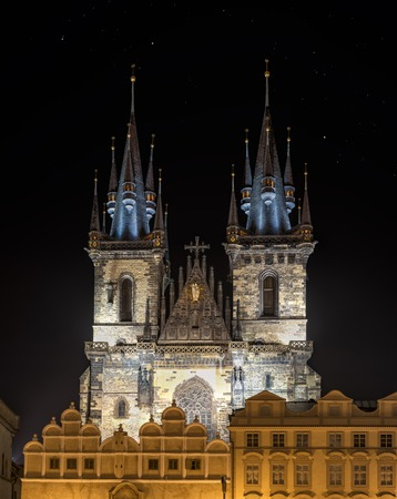 czech culture: Church of Mother of God (Our Lady) before Tyn was built in 15th century in late gothic style. The churchs towers are 80 m high and topped by four small spires. Stock Photo