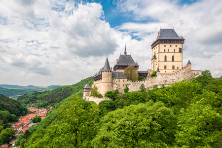 iv: Karlstein, Czech Republic - May 26, 2016: Karlstein Castle is a large Gothic castle founded in 1348 by King Charles IV, Holy Roman Emperor and King of Bohemia. The castle served as a place for safekeeping the Imperial Regalia, Bohemian  Czech crown jewel