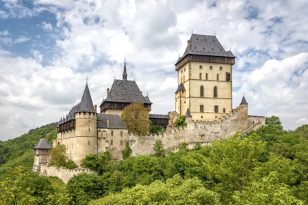 safekeeping: Karlstein, Czech Republic - May 26, 2016: Karlstein Castle is a large Gothic castle founded in 1348 by King Charles IV, Holy Roman Emperor and King of Bohemia. The castle served as a place for safekeeping the Imperial Regalia, Bohemian  Czech crown jewel