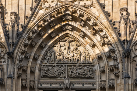 czech culture: Prague, Czech Republic - May 26, 2016: Close up view of central tympanun with Passion scene at Metropolitan Cathedral of Saints Vitus, Wenceslaus and Adalbert. Editorial