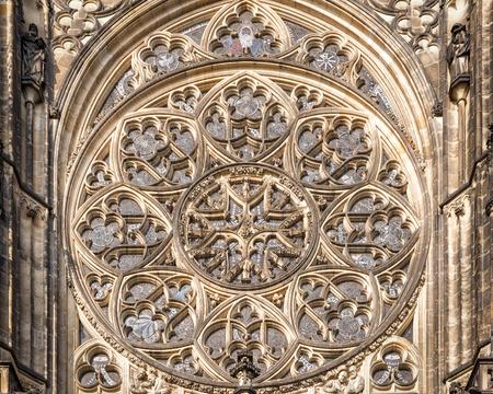 czech culture: Prague, Czech Republic - May 26, 2016: Close up view of rose window at Metropolitan Cathedral of Saints Vitus, Wenceslaus and Adalbert. Editorial