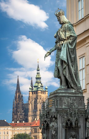 st charles: Prague, Czech Republic - May 28, 2016: King Charles IV monument at Crusaders Square in Prague. St. Vitus cathedral at Prague castle in background. Editorial
