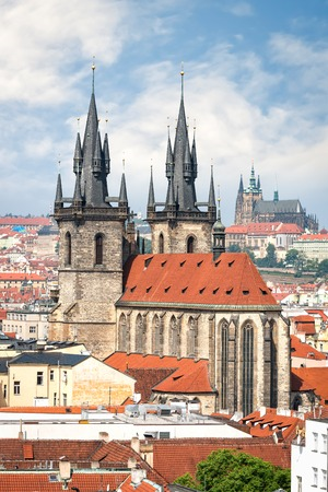 vitus: Aerial view of Tyn church in Prague old town and St. Vitus cathedral on background
