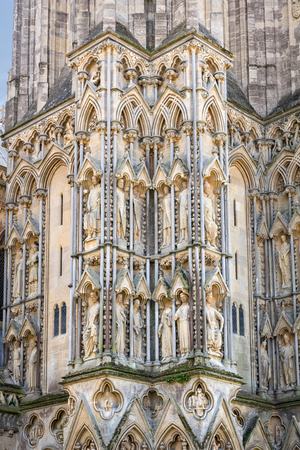 niches: Wells, United Kingdom - August 6, 2016: Sculpted figures gallery of royalty fills the niches of the north west buttress of Wells cathedral.