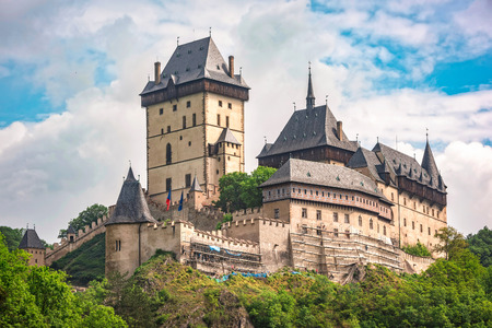 Karlstein, Czech Republic - May 26, 2016: Karlstein Castle is a large Gothic castle founded in 1348 by King Charles IV, Holy Roman Emperor and King of Bohemia. The castle served as a place for safekeeping the Imperial Regalia, Bohemian  Czech crown jewel