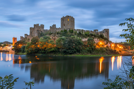 Pembroke, Wales, United Kingdom - September 22, 2016: Panoramic view of Pembroke Castle in South Wales at night