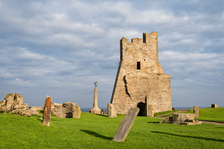 Aberystwyth, Wales, United Kingdom - September 21, 2016: View of remains of the north tower gateway at Aberystwyth Castle. Building work started in 1277 at the time of the First Welsh War. War Memorial is visible on background.