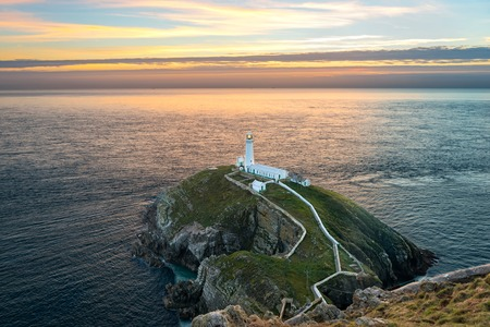 ynys: Holyhead, Wales, United Kingdom - September 17, 2016: South stack lighthouse on Holy Island at sunset