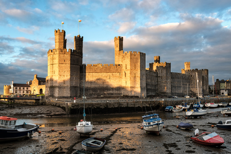 Caernarfon,  Wales, United Kingdom - September 19, 2016: Evening view of Caernarfon Castle with its polygonal towers in North Wales Editorial