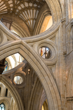 Wells, United Kingdom - August 6, 2016: St Andrews Cross arches under the tower inside Wells Cathedral Editorial