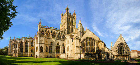 Panoramic view of Gloucester Cathedral Church of St Peter and the Holy and Indivisible Trinity on a sunny day Stock Photo