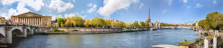 Panoramic view of Paris over river Seine with Alexander III bridge, Tour Eiffel and Assemblee Nationale. Copy space in blue sky.