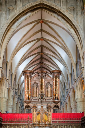 Gloucester, United Kingdom - June 8, 2013: View of Gloucester Cathedral organ and vaulted ceiling Editorial