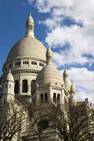 Paris, France - April 19, 2013: Dome and cupolas of basilica of Sacre-Coeur in Montmartre