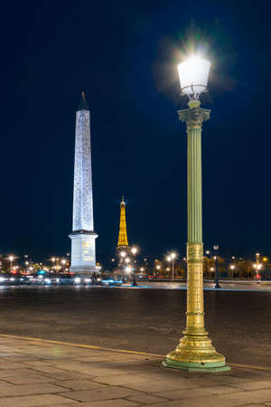 Night view of place de la Concorde. Eiffel tower on background. Copy space in sky.