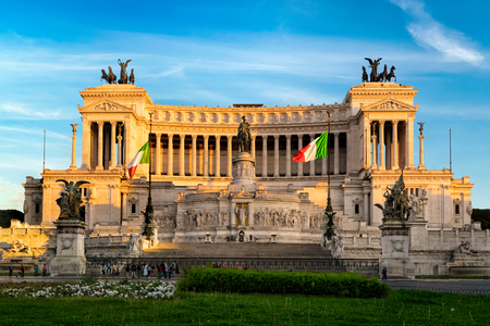 Rome, Italy - April 11, 2017: Altar of the Fatherland (Altare della Patria) known as the Monumento Nazionale a Vittorio Emanuele II or Il Vittoriano in Venezia square at sunset. Unidentified people present on picture.