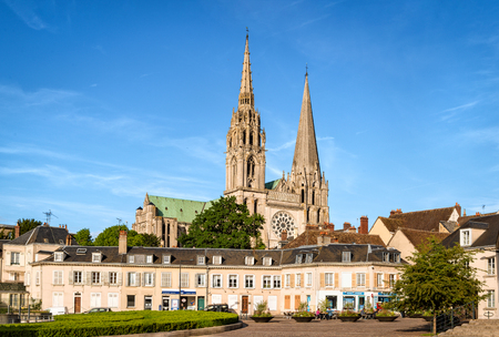 Chartres, France - May 21, 2017: View to Cathedral of Our Lady of Chartres from Place Chatelet. Unidentified people present on picture. Copy space in sky. Editorial