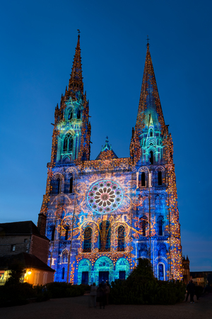 Chartres, France - May 21, 2017: Night illumination of the Cathedral of Our Lady of Chartres - Lumiere light show.
