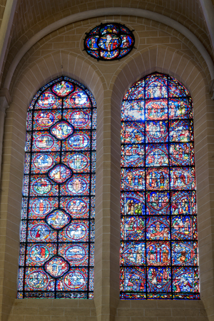 Chartres, France - May 22, 2017: View of South wall stained-glass windows in Chartres Cathedral.
