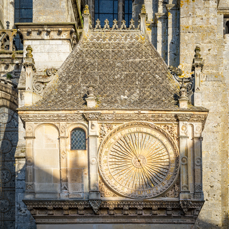 Chartres, France - May 21, 2017: Ancient astronomical clock on the North facade of the Cathedral of Our Lady of Chartres