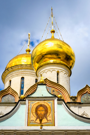 Segiyev Posad, Russia - August 30, 2012: View of the Trinity Cathedral domes and exterior wall painting at Holy Trinity St. Sergius Lavra.