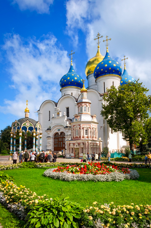 Segiyev Posad, Russia - August 30, 2012: View of central square in Holy Trinity St. Sergius Lavra with Well, Assumption Cathedral and Chapel. Unidentified people present on picture. Editorial