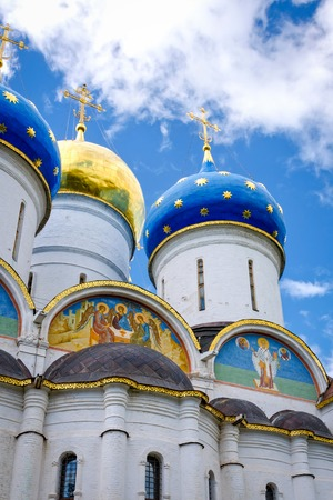 Segiyev Posad, Russia - August 30, 2012: View of the Assumption Cathedral domes and exterior wall painting at Holy Trinity St. Sergius Lavra.