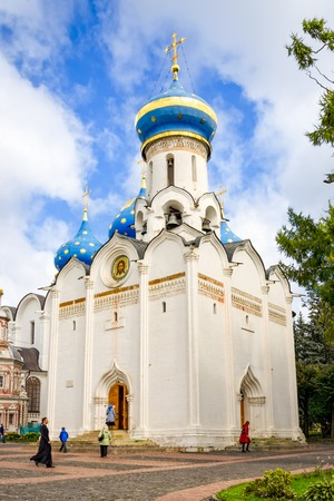 Sergiyev Posad, Russia - August 30, 2012: View of Church of the Descent of the Holy Spirit at Holy Trinity St. Sergius Lavra. Unidentified people present on picture.