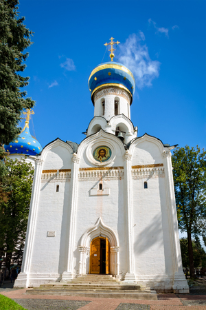View of Church of the Descent of the Holy Spirit at Holy Trinity St. Sergius Lavra in Russia. Copy space in blue sky. Stock Photo