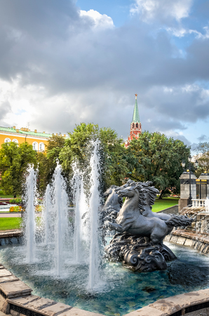 Moscow, Russia - August 31, 2012: Fountain Four seasons at the Manege (Manezhnaya) square next to Kremlin. Copy space in sky.