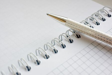 pen on the open notebook Stock Photo - 5997809