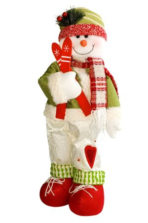 Soft-toy snowman with skis in sportswear isolated over white 版權商用圖片