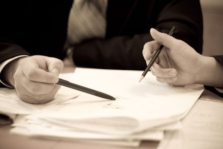 Two men with pencils in hand to discuss the scheme, DOF Stock Photo