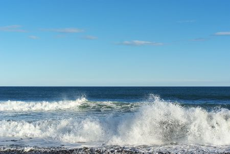 ocean surf on the coast, on a clear sunny day Stock Photo