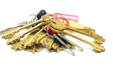 Many iron keys on a white background