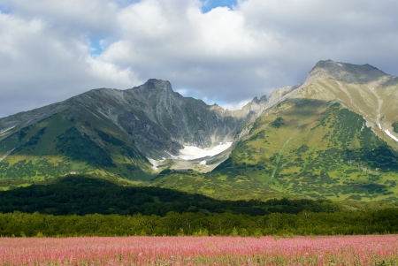 old sullen and majestic volcano, Kamchatka, a tourist destination route  Stock Photo