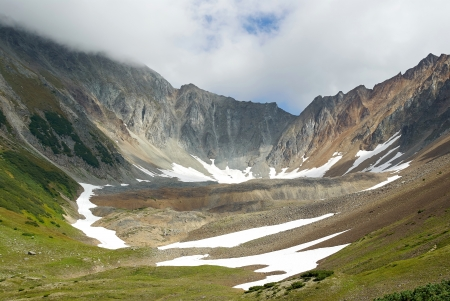 the crater of an old volcano surly and magnificent, a tourist destination in Kamchatka Stock Photo