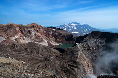 At the top of the volcano are visible: crater lake, gases sulfur fumaroles, and the nearby volcano Stock Photo