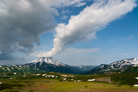 general view of the Vilyuchinsky volcano with a long cloud on top Stock Photo