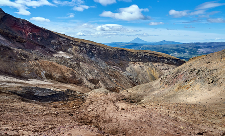Walking route in the crater of the active volcano Mutnovsky on the Kamchatka Peninsula. Canyon at the entrance to the caldera of the volcano. Stock Photo