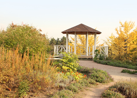 Beautiful wooden gazebo in autumn garden