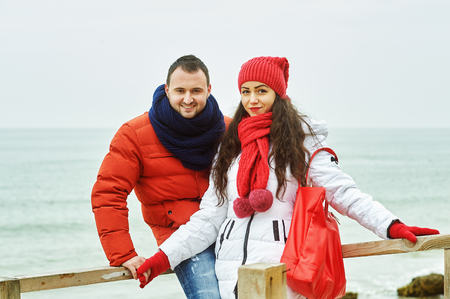 Young loving couple on a walk, dressed in bright clothes