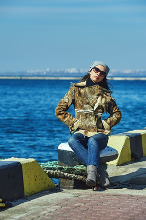Fashionable girl in glasses on the background of the sea Stock Photo