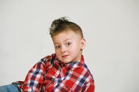 portrait of a beautiful boy . Stylish boy posing . the concept of childrens fashion